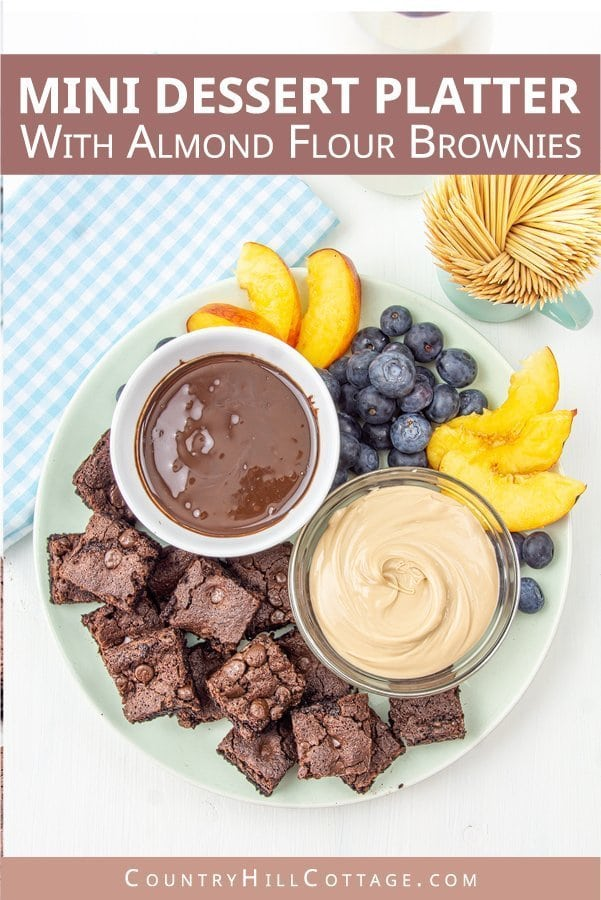 Mini Dessert Platter with gluten free almond flour brownie bites, chocolate sauce, nut spread and fresh fruits. An easy presentation with chocolate and fruits perfect for sharing at parties and entertaining. A simple and beautiful DIY dessert platter idea with sweets and treats great for entertaining. A small plate is used as a party tray and decorated with healthy chocolate cake and candy. Great for kids and for two to share. #dessertplatter #partyfood #fingerfood| countryhillcottage.com
