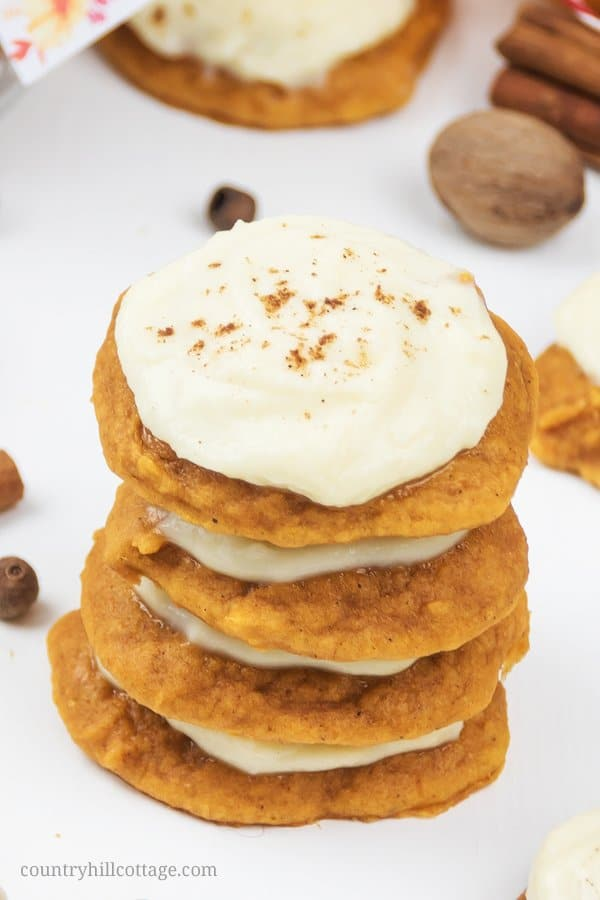 The best chewy gluten free vegan pumpkin cookies with cream cheese frosting! The fall flavored cookies are made of soft pumpkin cookies seasoned with pumpkin pie spice and topped with vegan cream cheese frosting. These homemade bakery-style iced pumpkin cookies are a delicious fall baking recipe and great gluten free cookie idea. This healthy pumpkin spice cookie recipe is a great food gift for Halloween & Thanksgiving. #pumpkin cookies #vegan #glutenfree #pumpkinspice | countryhillcottage.com