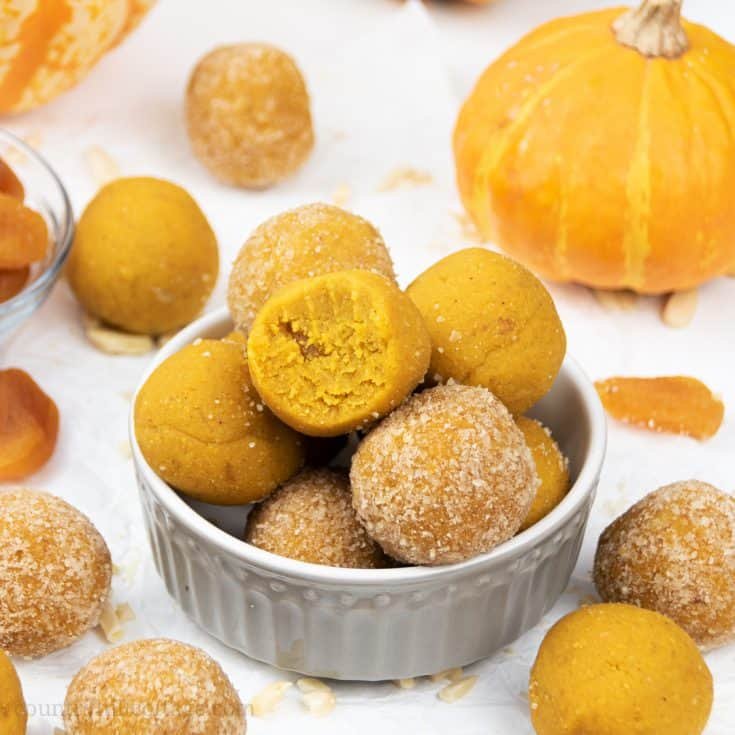 Learn how to make vegan no-bake pumpkin energy balls! Made in the food processor with pumpkin spice, raw almonds and coconut flour, this easy homemade energy bites recipe makes delicious pumpkin truffles. The pumpkin balls taste like pumpkin pie, donut holes & cake bites. This quick healthy snacks recipe is gluten-free, paleo & Whole30. ideal for kids, clean eating, breakfast, lunch or dessert. Grain fee, no added sugar, dairy free. #energyballs #vegan #nobake #pumpkin | countryhillcottage.com