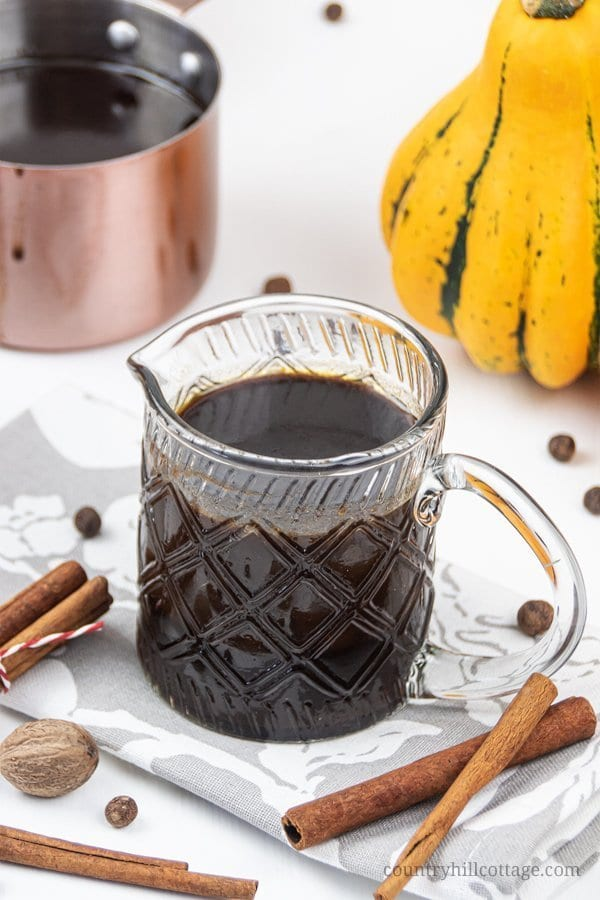 Made with real pumpkin and spices, this homemade vegan pumpkin spice syrup recipe is the per-fect condiment to perk up your favourite healthy fall dessert and breakfast recipes - from pancakes and waffles to coffee & pumpkin spice latte or cocktails. This gluten free dairy free pumpkin syrup is ready in 10 minutes. Better than Dunkin Donuts or Starbucks! Sugar free Keto & Paleo option! #pumpkinspice #syrup #latte #pumpkinspicelatte #coffee #breakfast #vegan #paleo #keto | countryhillcottage.com