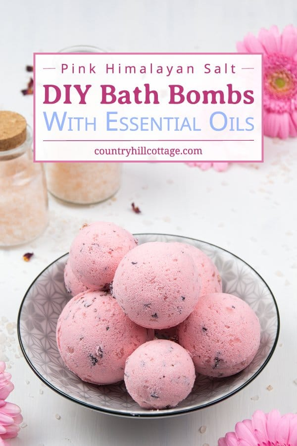 Whether you need at-home relaxation or want to jazz up bath time, easy fizzy DIY Himalayan salt bath bombs are a true wellness treat. Made with skin-smoothing shea butter and soothing essential oils, the simple homemade moisturizing bath fizzies are the best way to enjoy the balancing effects of a salt bath and benefits of aromatherapy. Lush inspired natural bath bomb recipe (no cornstarch, without corn starch) and natural scents. #bathbomb #aromatherapy #essentialoils | countryhillcottage.com