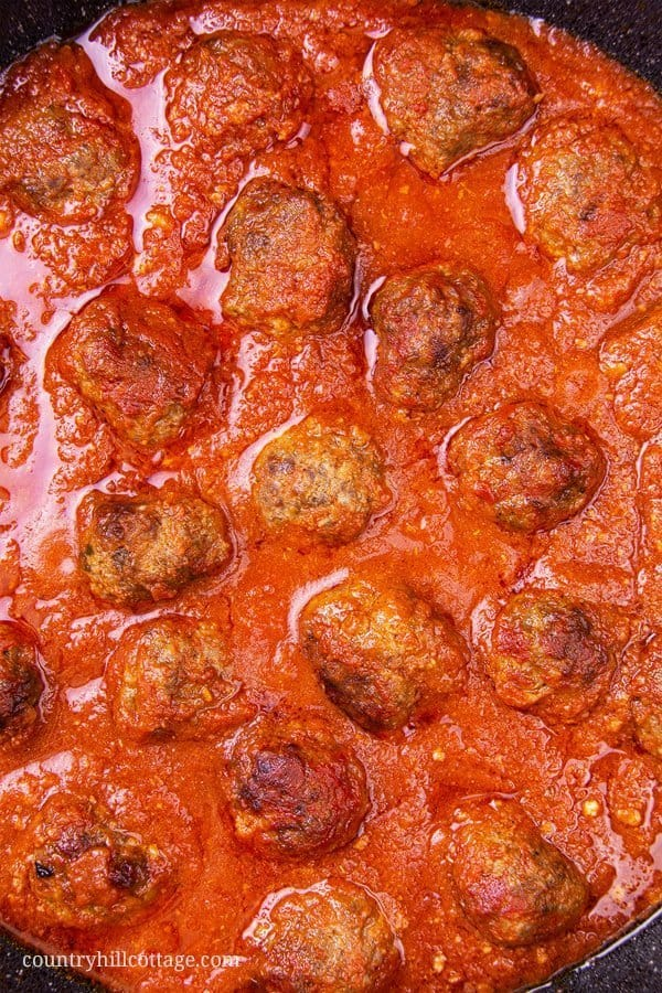 Easy homemade keto meatballs are great for kids and real family favourite! Our simple healthy homemade ketogenic meatball recipe with ground beef without breadcrumbs shows how to make gluten free Italian slow cooker meatballs in a low carb marinara sauce, perfect for the crockpot or Instant Pot. Recipe includes instructions for the stovetop to make traditional meatballs in 30 min. Spaghetti squash and meat balls are a tasty dinner & appetizer. Grain free, no breadcrumbs. | countryhillcottage.com
