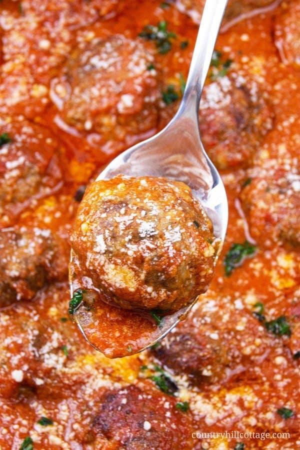 Easy homemade keto meatballs are great for kids and real family favourite! This simple healthy homemade ketogenic meatball recipe with ground beef without breadcrumbs shows how to make gluten free Italian slow cooker meatballs in a low carb marinara sauce, perfect for the crockpot or Instant Pot. Zucchini spaghetti and keto meat balls are a tasty dinner and yum appetizer. Grain free, can be frozen in the freezer, great for a baked oven casserole or soup, no breadcrumbs. | countryhillcottage.com