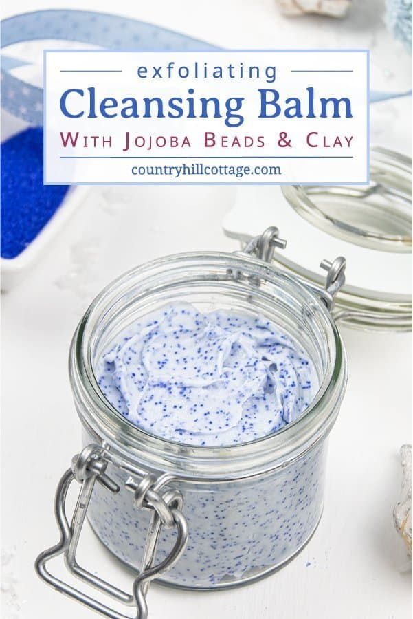 Learn how to make an exfoliating DIY cleansing balm with jojoba beads! This vegan facial scrub is a four-in-one treatment: the non-comedogenic oils are a make up remover and natural skincare moisturizer, kaolin clay draws out impurities and cleanses, and the jojoba beads exfoliate your face. This gentle face polish recipe and non-abrasive homemade exfoliator is suitable for dry skin, oily skin, and acne. #cleansingbalm #facescrub #facialscrub #facepolish #jojobabeads | countryhillcottage.com