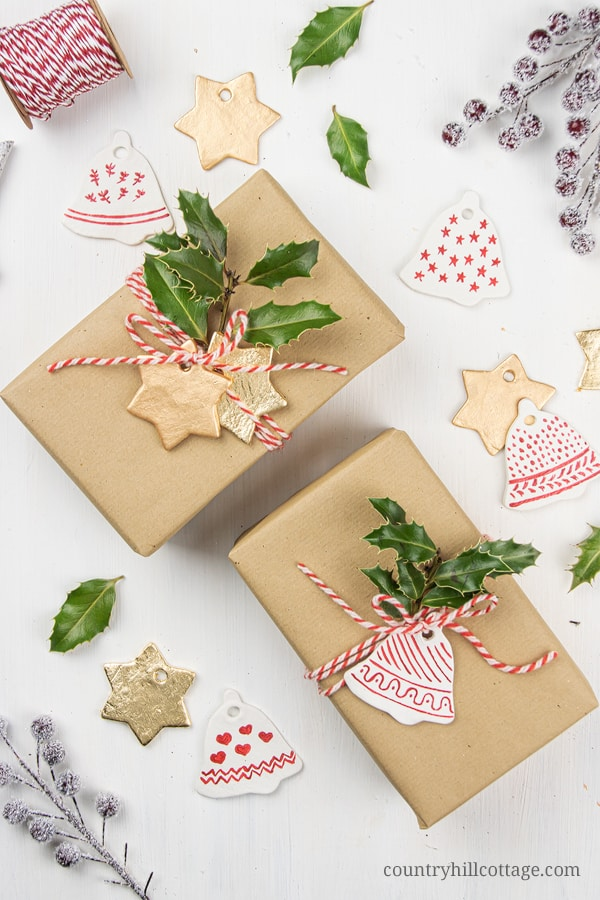 Aside from decorating, use DIY Christmas ornaments as gifts and for gift wrapping. Paired with a cute Christmas card, you can gift homemade clay holiday ornaments as an inexpensive gift idea to co-workers, neighbours, or as a teacher gift or hostess gift. Clay ornaments are also lovely accessories for gift wrapping. The possibilities to decorate gifts with Christmas clay tags are literally endless! #gift #giftwrapping #christmasornaments #homemade #ornaments #holidays | countryhillcottage.com