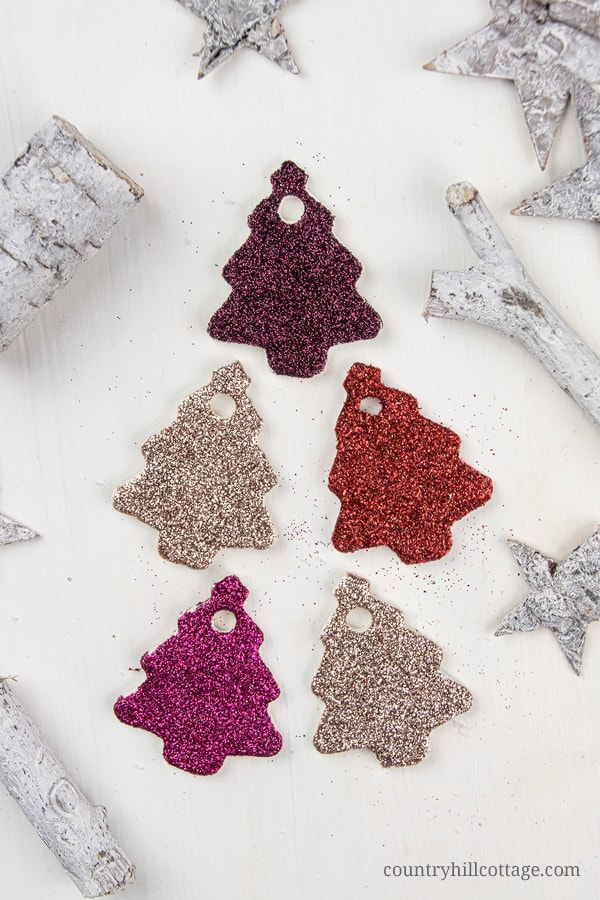 DIY Christmas Glitter Ornaments! Homemade clay ornaments are beautiful and easy DIY cookie cutter ornaments and a simple winter craft. In this step-by-step tutorial with pictures, you'll learn how to make ornaments like vintage painted snowflakes, rustic farmhouse jingle bells and beautiful glitter stars. You can use DIY Christmas ornaments as gifts and tree decorations. Great for kids and classroom! #christmasornaments #homemade #ornaments #holidays | countryhillcottage.com
