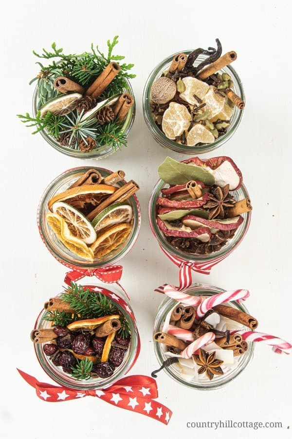 See how to make a DIY stovetop potpourri gift! These simmer potpourris make your house smell like Christmas and dry potpourri recipes are wonderful homemade holiday gift ideas. The tutorial for Christmas potpourri in a jar comes with free printable labels and gift tags for packaging and gifting. DIY Mason jar gifts. Christmas in a jar. Natural air freshener. Aromatherapy potpourri. #holidaygift #diygift #christmas #potpourri #airfreshener #stovetoppotpourri #simmerpot | countryhillcottage.com