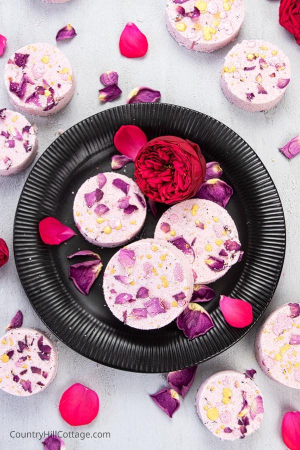 DIY rose petal bath bombs on a plate