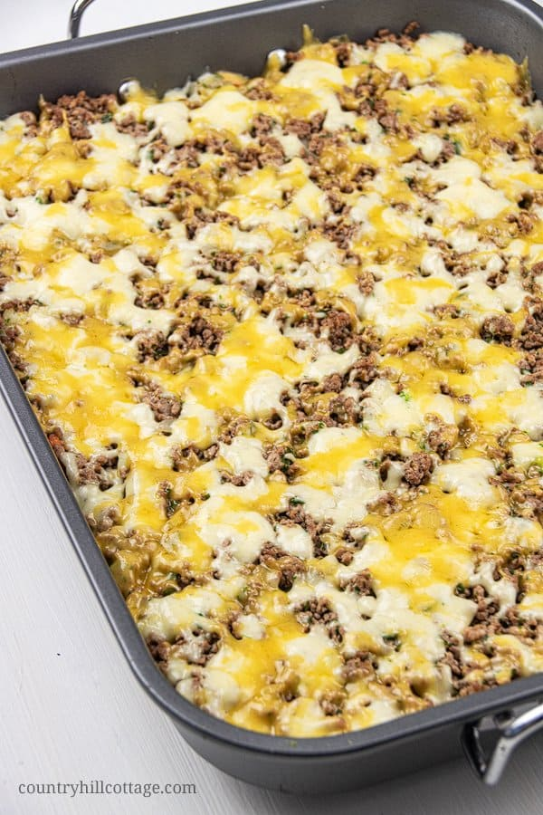 This easy low carb keto ground casserole recipe with cauliflower and stir fry broccoli is a quick dinner idea for families dish and great for weeknight meals and midweek dishes. Simple keto ground beef recipe is gluten-free comfort food and perfect to feed a crowd or for a potluck. The healthy casserole recipe also includes seasoning tips and variations (cheeseburger casserole) for the best skinny beef casserole ever. #casserole #ketocasserole #groundbeef #lowcarb #keto | countryhillcottage.com