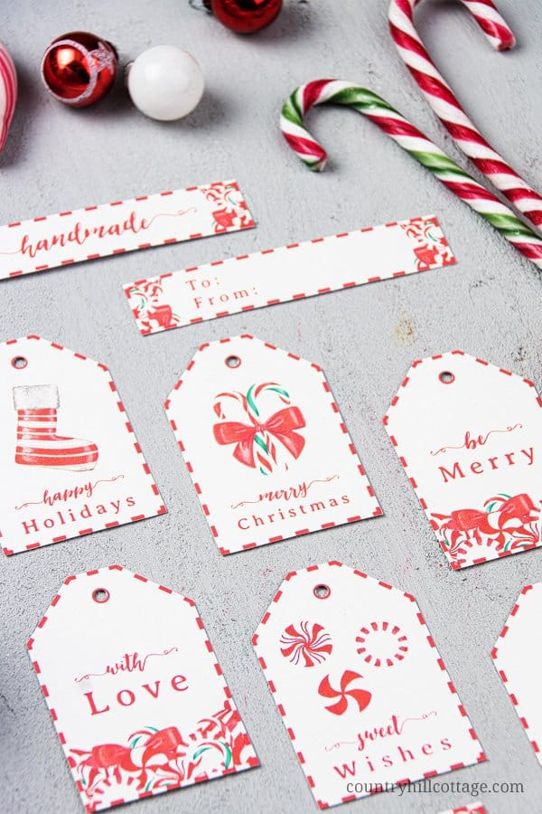 Decorate Christmas presents with free printable candy cane gift tags! These pretty DIY holiday gift tags are an easy seasonal craft project and are a wonderful way to dress up handmade holiday gifts. Tap the image to download this set of 9 Christmas gift tag printables and gift wrap your goodies in style! The simple candy cane design is great for teachers, kids, neighbors and friends. #gifttag #holidaygifttags #christmasgifttags #gift #tag #DIYtags #Christmas #Holidays | countryhillcottage.com