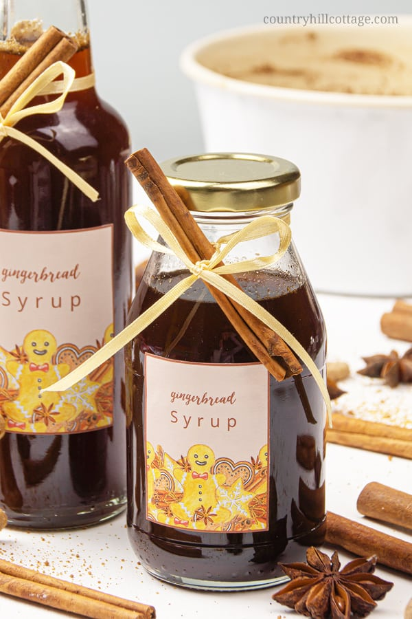 How to make gingerbread syrup! Healthy easy Christmas syrup is a quick, easy and inexpensive sweet Christmas food gift recipe for family, friends, teachers, coworkers. Use this spiced syrup for pancake, waffle, ice cream, desserts, coffee, latte, cocktails. The homemade syrup recipe is vegan, gluten-free, and paleo-friendly. The unique handmade holiday gift comes with free printable labels for packaging and gift wrapping. #foodgift #holidaygift #christmasgift #printable | countryhillcottage.com