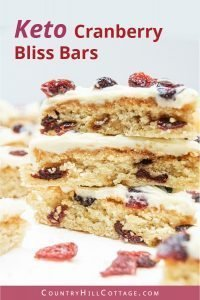 This low carb gluten-free cranberry bliss bars recipe is a delicious and healthy keto holiday treats idea! The easy homemade Starbucks copycat cranberry bars taste just like from the coffeeshop but are dairy-free and thm. The iced cranberry bars are keto, paleo, and clean eating friendly. Plus, iced keto cranberry blondies are a delicious Christmas food gift and holiday dessert. Keto holiday recipes. #cranberryblissbars #lowcarb #glutenfree #keto #paleo #skinnytaste | countryhillcottage.com