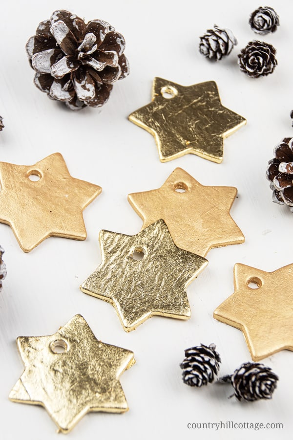 DIY Star Gold Leaf Ornaments for Christmas! Homemade clay ornaments are beautiful and easy DIY cookie cutter ornaments and a simple winter craft. In this step-by-step tutorial with pictures, you'll learn how to make ornaments like vintage painted snowflakes, rustic farmhouse jingle bells and beautiful glitter stars. You can use DIY Christmas ornaments as gifts and tree decorations. Great for kids and classroom! #goldleaf #christmasornaments #homemade #ornaments #holidays | countryhillcottage.com