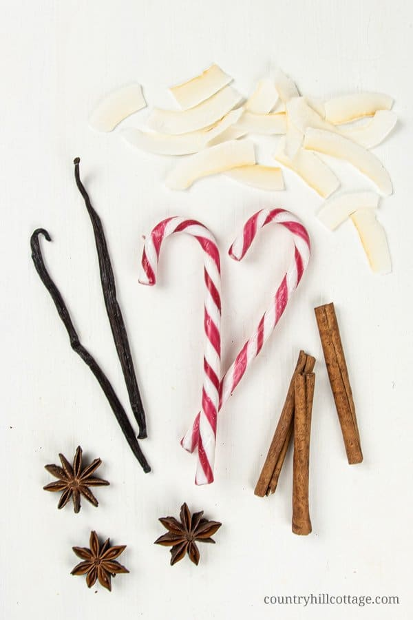This Christmas potpourri in a jar is one for candy lovers. Fresh vanilla beans, cinnamon and real candy canes give this candy cane vanilla stovetop simmer a sweet, minty aroma. See how to make a DIY stovetop potpourri gift! Simmer potpourris make your house smell like Christmas and dry potpourri recipes are wonderful homemade holiday gift ideas. The tutorial comes with free printable labels for packaging. #christmas #potpourri #airfreshener #stovetoppotpourri #simmerpot | countryhillcottage.com