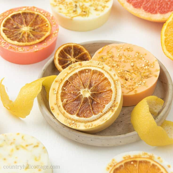 This homemade citrus soap recipe has an uplifting scent, rich lather and many skin care benefits. Natural DIY lemon soap bars are made with goat milk, shea butter or glycerin melt and pour base and essential oils - ideal for soap making for beginners! The handmade tutorial shows how to make melt and pour soap, gives different citrus essential oil blends for soap, tips for molds, packaging ideas and more recipes inspiration. Cute hand soap teacher gift! #soap #soapmaking | countryhillcottage.com