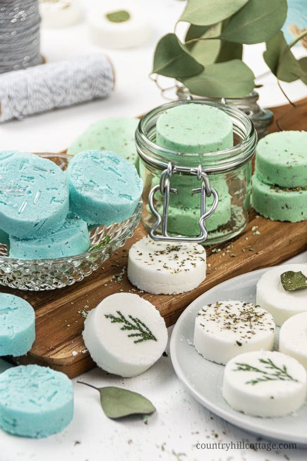 See how to make and how to use the best DIY shower steamers for health and wellness recipes. Made with cornstarch and baking soda, quick and easy natural shower bombs are good for colds, sinus congestion, headache or as Christmas gift. Relaxing homemade essential oils aromatherapy shower melt scents include decongestant eucalyptus and peppermint-menthol - like Vicks vapor rub! Includes tips for packaging and storage. Without witch hazel. #showersteamers #aromatherapy | countryhillcottage.com
