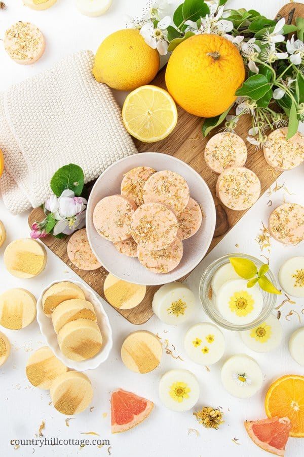 See how to make 3 easy natural shower bombs recipe for wake up shower melts, uplifting citrus shower steamers and energizing shower fizzies. Relaxing aromatherapy shower melts are like homemade bath bombs but for the shower, perfect for wellness and a spa day at home. The simple homemade bath product tutorial includes tips for how to use, herbal shower steamers without citric acid, packaging. Cute DIY beauty gift. #showerbombs #showersteamer #essentialoils #aromatherapy | countryhillcottage.com