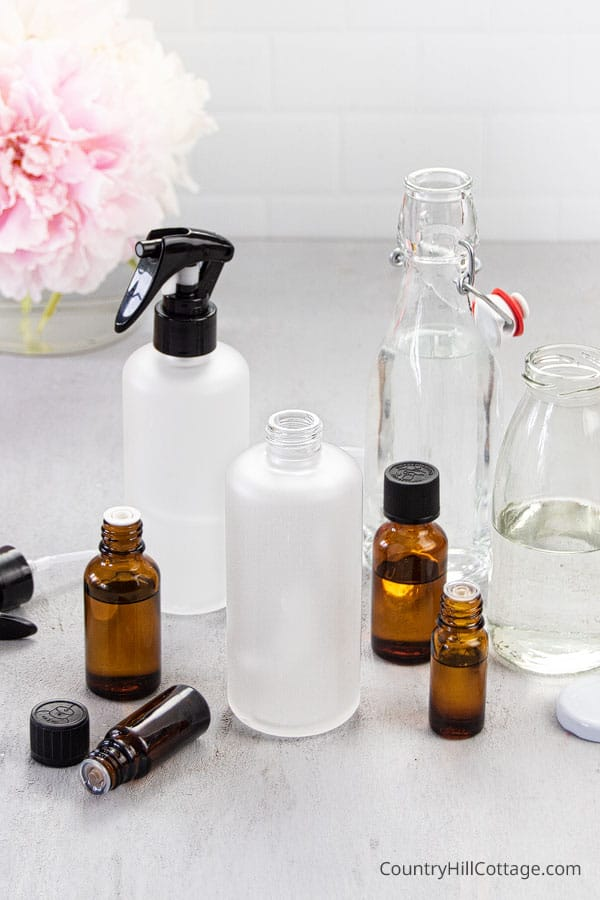 Ingredients and materials to make DIY room spray with essential oils