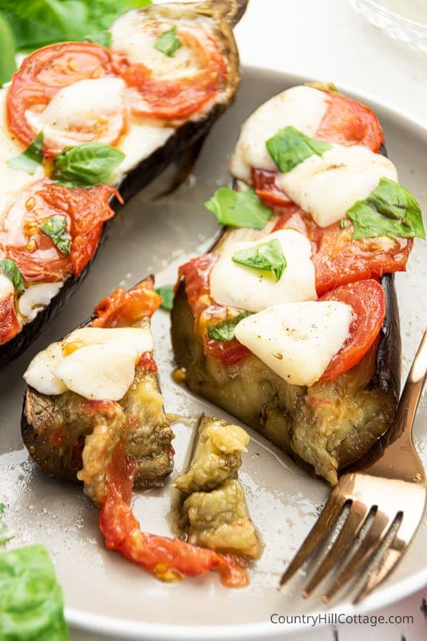 Plate with serving of oven baked eggplant with mozzarella cheese