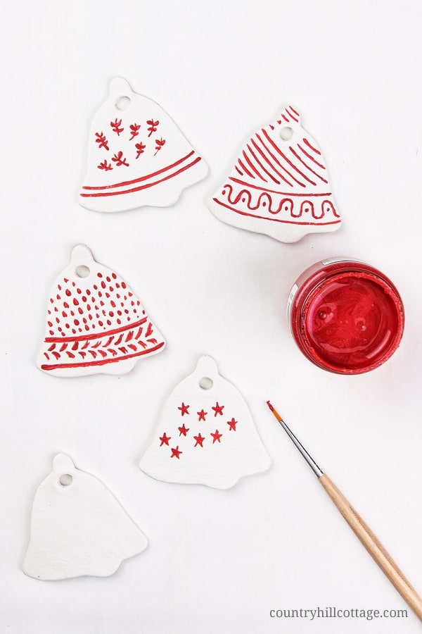 Easy Painted Christmas Ornaments Hygge Style! Homemade clay ornaments are beautiful and easy DIY cookie cutter ornaments and a simple winter craft. In this step-by-step tutorial with pictures, you'll learn how to make ornaments like vintage painted snowflakes, rustic farmhouse jingle bells and beautiful glitter stars. You can use DIY Christmas ornaments as gifts and tree decorations. Great for kids and classroom! #christmasornaments #homemade #ornaments #holidays | countryhillcottage.com