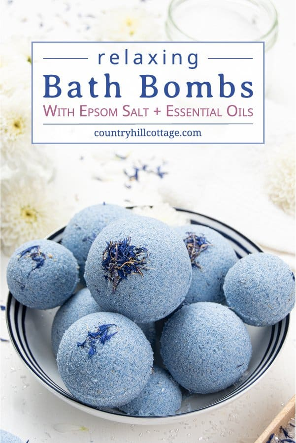See how to make your own best relaxing bath bombs with Epsom salt! The easy fizzy relaxation Epsom salt bath bombs recipe is made with all natural ingredients and essential oils. The simple tutorial shows tips for aromatherapy bath bomb making, and also includes ideas for bath bomb scents and tips for bath bomb storage. Great for kids, men, sleep, anxiety, skincare, spa day, wellness, sensitive skin and eczema, without cornstarch. #bathbombs #aromatherapy #essentialoils | countryhillcottage.com