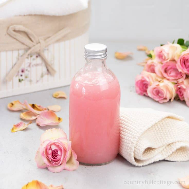 See how to make moisturizing vegan DIY rose body wash recipe without castile soap that lathers an is best smelling! The easy liquid homemade shower gel is a mild cleanser great for eczema, acne, dry and sensitive skin. This pH-balanced rose water body wash foams beautifully, has a rich lather and lush gel texture. The tutorial shows how to make good foaming all natural body wash with organic coconut oil, glycerin and essential oils plus tips for bottles and packaging. | countryhillcottage.com