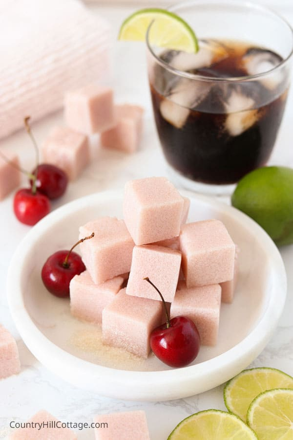 Homemade sugar scrub cubes on marble plate