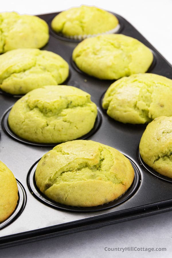 freshly baked pistachio muffins in a muffin tray