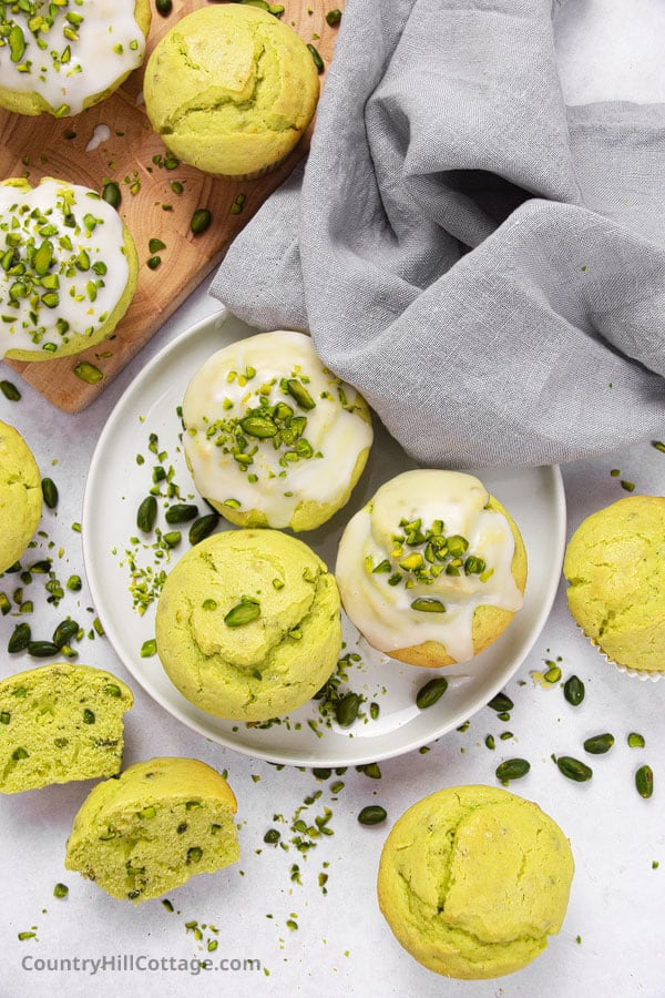 pistachio muffins with real pistachios on a plate